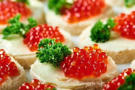 Tasty restaurant apetizer with red caviar and parsley. Good for buffet, catering and other meals with light alcohol drinks.