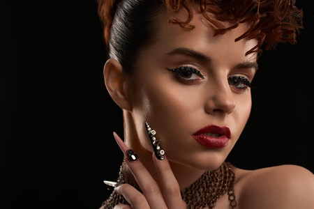 Portrait of model wearing nail art and bright make up. Stock Photo