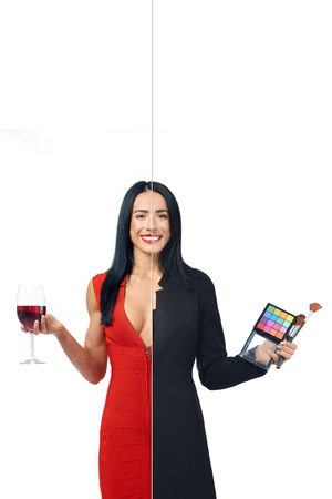 Adorable girl in two occupations of model and makeup artist isolated on white background. Model with ideal figure in red dress with glass of red wine and makeup artist with palette of eye shadows.