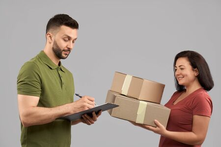 Delivery service for shopping and commercial. Confident young man working in fast shipping and delivering order for client. Concept of delivery and logistics.