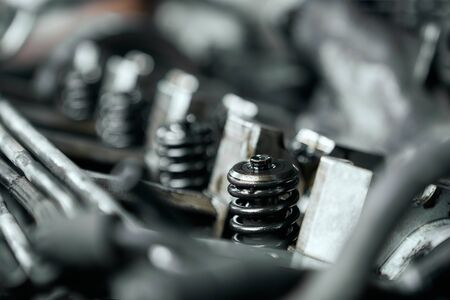 Close up of nozlzle of car engine under opened bonnet that was changed by professional mechanic in service center. Scheduled diagnostic and maintenance of vehicle