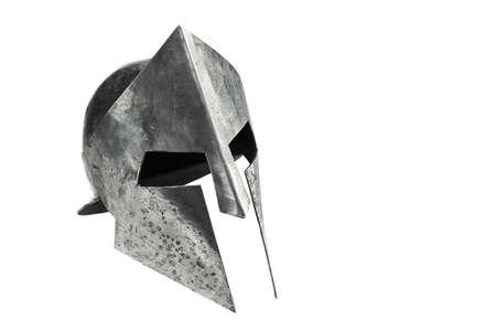 Medieval armor, archeological souvenir from past, iron head antique protection. Side view of ancient metal tough spartan helmet isolated on white studio background.