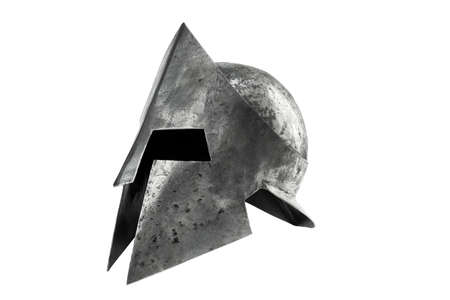 Side view of ancient metal tough spartan helmet isolated on white studio background. Medieval armor, archeological souvenir from past, iron head antique protection.