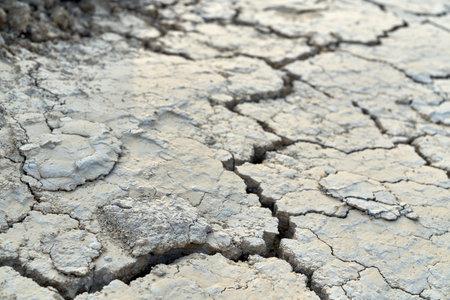 Top view of huge split in dirty soil. Concept of drought in desert. 免版税图像