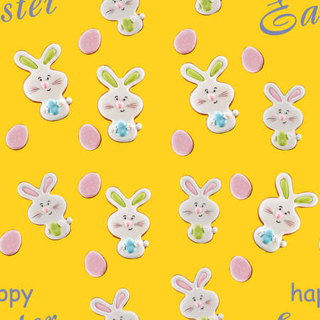 From above view of colorful ginger glazed cookies isolated on yellow background with grey words. Close up of homemade lovely delicious pastry in shape of easter bunnies and eggs.