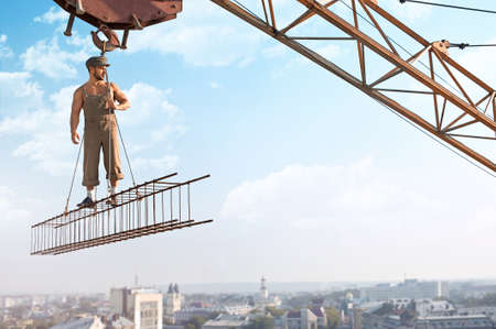 New day new step. Shot of a construction worker with muscular body posing on a metal crossbar hanging on the top of a skyscraper under construction