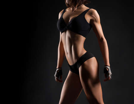 Personal trainer. Cropped portrait of a fitness woman wearing workout gear posing in studio