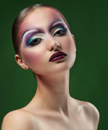 Abstract thoughts. Vertical shot of a young model wearing professional colorful makeup