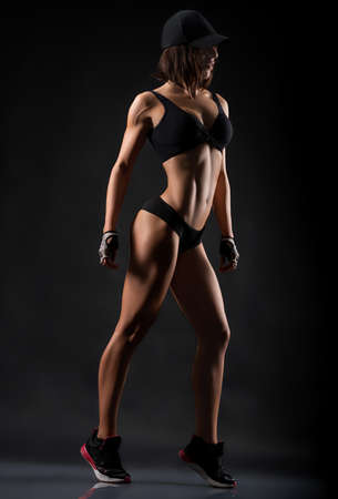 She is motivation. Full length studio shot of a fitness woman wearing workout clothing posing showing off her perfect strong body