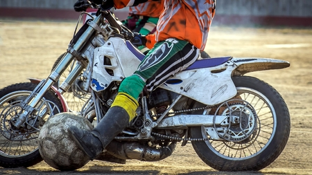 episode: Motoball. Episode rivalry between the two athletes. Close-up of motorcycles and a large ball. Stock Photo