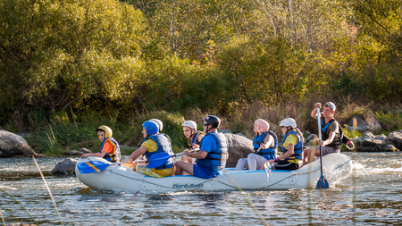 risky: Village Myhiya, Nikolaev region, Ukraine - September 10, 2016: Rafting on the Southern Bug River. An experienced instructor holds the key to a great adventure. Rafting in Ukraine. Fun, risky, bold action.