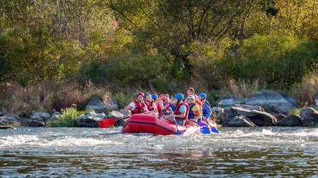 Village Myhiya, Nikolaev region, Ukraine - September 10, 2016: Rafting on the Southern Bug River. An experienced instructor holds the key to a great adventure. Rafting in Ukraine. Fun, risky, bold action.