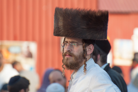 Jew Hasid ethnic headdress. Uman, Ukraine - October 2, 2016: Every year, thousands of Orthodox Bratslav Hasidic Jews from different countries gather in Uman to mark Rosh Hashanah, Jewish New Year, near the tomb of Rabbi Nachman. 5777 New Year. The entranc
