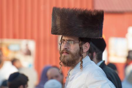 Jew Hasid ethnic headdress. Uman, Ukraine - October 2, 2016: Every year, thousands of Orthodox Bratslav Hasidic Jews from different countries gather in Uman to mark Rosh Hashanah, Jewish New Year, near the tomb of Rabbi Nachman. 5777 New Year. The entranc