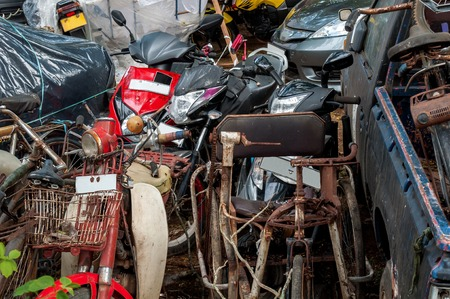 damaged vehicles: Scrap Metal. A pile of rusty metal. Broken, damaged vehicles.