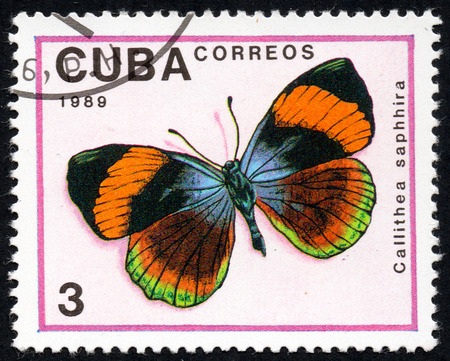 UKRAINE - CIRCA 2017: A stamp printed in Cuba, shows image of a butterfly Callithea saphhira close-up, circa 1989 Editorial