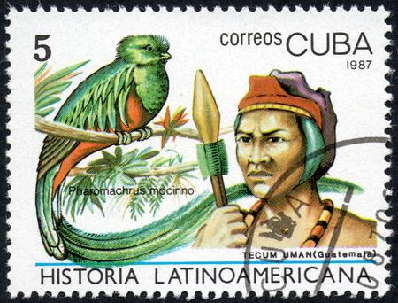 UKRAINE - CIRCA 2017: A stamp printed in Cuba, shows Image of a chieftain Tecum Uman Guatemala and bird Pharomachrus mocinno, the series Latin American history, circa 1987