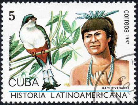 UKRAINE - CIRCA 2017: A stamp printed in Cuba, shows Image of a chieftain Hatuey Cuba and bird Cuban Trogon Priotelus temnurus, the series Latin American history, circa 1987