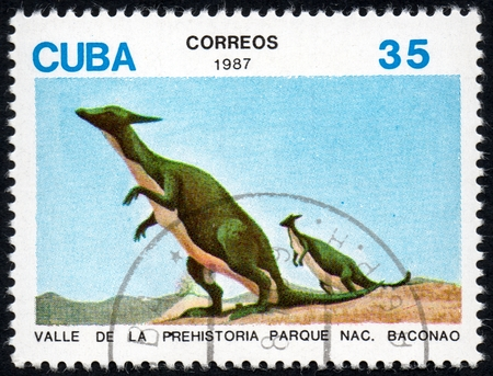 comprise: UKRAINE - CIRCA 2017: A stamp printed in Cuba, shows a extinct animals from the park of dinosaurs in the reserve Baconao, the series Valle de la prehistoria parque nac. Baconao, circa 1987
