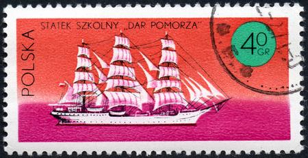 UKRAINE - CIRCA 2017: A stamp printed in Poland shows three-masted sailing ship Dar Pomorza, series Ships under the Polish Flag, circa 1971