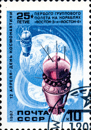 vostok: UKRAINE - CIRCA 2017: A stamp printed in the USSR shows First group flight aboard Vostok, April 12 - Day of Astronautics, circa 1987