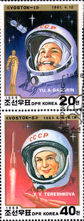tereshkova: UKRAINE - CIRCA 2017: A set of two postage stamps printed in DPR KOREA shows first cosmonaut Gagarin and first cosmonaut woman Tereshkova, circa 1988