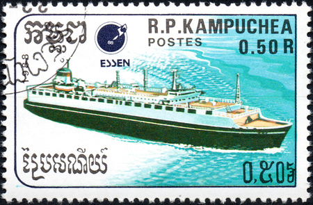 UKRAINE - CIRCA 2017: A postage stamp 0.5R printed Cambodia shows ship, circa 1988