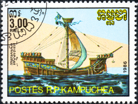 UKRAINE - CIRCA 2017: A postage stamp 3.00R printed in Cambodia shows old sailing ship cog, series Medieval Ships, circa 1986