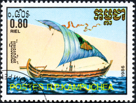 UKRAINE - CIRCA 2017: A postage stamp 0.80R printed in Cambodia shows old sailing ship Nile barge, series Medieval Ships, circa 1986