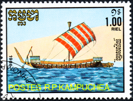 UKRAINE - CIRCA 2017: A postage stamp 1.00R printed in Cambodia shows old sailing ship Galley, series Medieval Ships, circa 1986