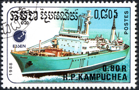 UKRAINE - CIRCA 2017: A postage stamp 0.80R printed Cambodia shows ship, circa 1988