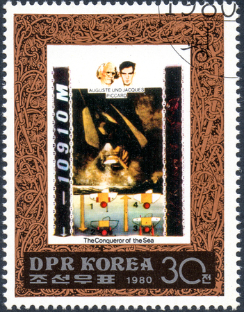 UKRAINE - CIRCA 2017: A postage stamp printed in DPR North Korea shows Auguste and Jacques Piccard, serie The Conqueror of the Sea, circa 1980