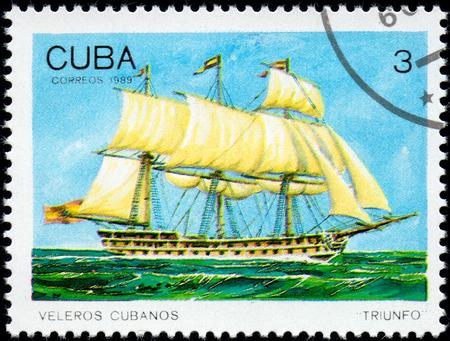UKRAINE - CIRCA 2017: A postage stamp printed in Cuba shows sailing ship Triunfo Triumph, from the series Cuban sailboats, circa 1989
