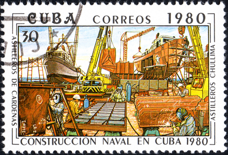 UKRAINE - CIRCA 2017: A postage stamp printed in Cuba shows Shipyards chullima from series Constructing of ships on Cuba, circa 1980 Editorial