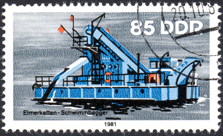 UKRAINE - CIRCA 2017: A postage stamp printed in DDR shows ship Bucket Dredger, River Boat, circa 1981 Editorial