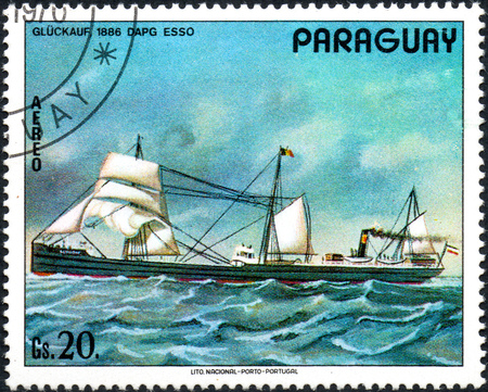 UKRAINE - CIRCA 2017: A postage stamp printed in Paraguai shows ship Good luck 1886 Dapg Esso, from the series Ship painting, circa 1976