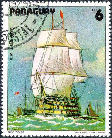 britannia: UKRAINE - CIRCA 2017: A postage stamp printed in Paraguai shows Sailing Ship HMS Britannia, from the series Sailboat painting, circa 1979 Editorial