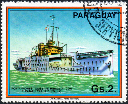 UKRAINE - CIRCA 2017: A postage stamp printed in Paraguai shows Italian aircraft carrier, from the series Carriers and Airplanes, circa 1983