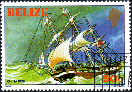 UKRAINE - CIRCA 2017: A postage stamp printed in Belize shows sailing ship China 1838, from the series Historic ships, circa 1982