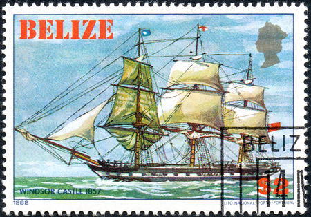 UKRAINE - CIRCA 2017: A postage stamp printed in Belize shows sailing ship Windsor Castle 1857, from the series Historic ships, circa 1982