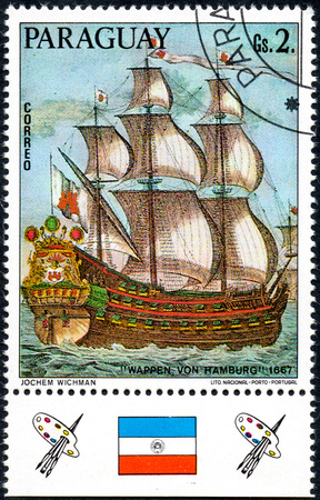 UKRAINE - CIRCA 2017: A postage stamp printed in Paraguay shows sailing ship Wappen von Hamburg 1667, from the series German sailing ships, circa 1976