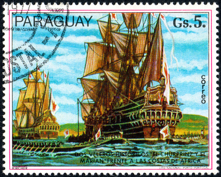 UKRAINE - CIRCA 2017: A postage stamp printed in Paraguay shows two sailing ships, from the series Paintings German ships, circa 1977 Editorial