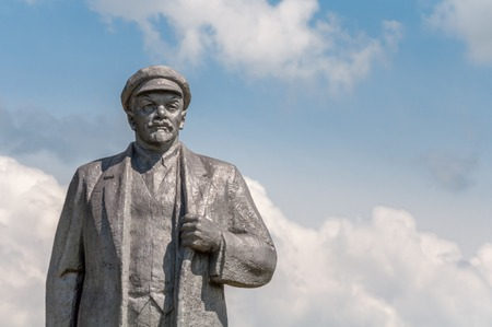 Kremenivka, Ukraine - May 21, 2017: The monument to Vladimir Lenin, the Soviet leader. Stone statue with a view to the sky. Back view. Editorial