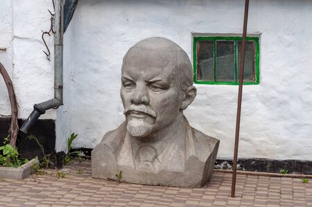 communism: Kremenivka, Ukraine - May 21, 2017: The bust to Vladimir Lenin, the Soviet leader. Stone statue. Decommunization.