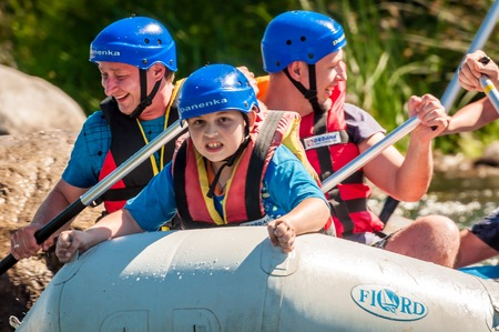 Village Myhiya, Nikolaev region, Ukraine - July 2, 2017: Kids and rafting. A popular place for extreme family recreation and training of athletes in rafting and kayaking.