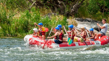 Mihia, Ukraine - July 9, 2017: Rafting. A popular place for extreme family and corporate recreation as well as training for athletes. Children enthusiastically participate in the extreme.