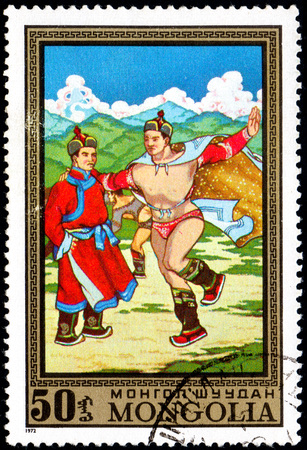 UKRAINE - CIRCA 2017: A postage stamp printed in Mongolia shows Athletes, Two men dance from the series Paintings by contemporary artists in Ulan Bator Museum, circa 1972