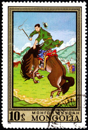 UKRAINE - CIRCA 2017: A postage stamp printed in Mongolia shows Taming Wild Horse from the series Paintings by contemporary artists in Ulan Bator Museum, circa 1972 Éditoriale