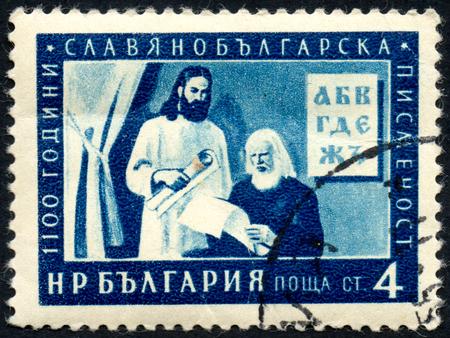 UKRAINE - CIRCA 2017: A postage stamp printed in Bulgaria shows writer, the Slavic-Bulgarian alphabet 1100 anniversary, circa 1955