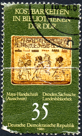 UKRAINE - CIRCA 2017: A stamp printed in DDR shows Maya manuscript, from series Treasure In The Library Of The GDR circa 1981